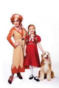 ANNIE - Lesley Joseph as Miss Hannigan with Annie and Sandy. Photo credit Matt Crockett